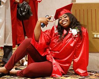 ROBERT K.YOSAY  | THE VINDICATOR..Chaney High School class of 2019. Stambaugh Auditorium ..taking a moment before graduation Nyrah Simmons