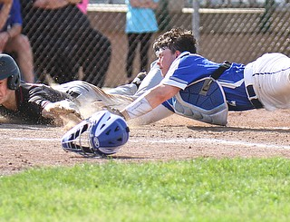 William D. Lewis The Vindicator  Canfield;'s Brayden Beck(9) scores as Poland catcher MJ Farber(25) tries to make the tag durig 5-23-19 action at Cene.