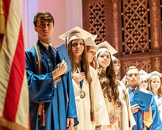 DIANNA OATRIDGE | THE VINDICATOR  The valedictiorians of Hubbard High School's Class of 2019 salute the flag during the playing of the National Anthem at their commencement ceremony at Stambaugh Auditorium on Wednesday.