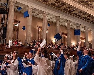 DIANNA OATRIDGE | THE VINDICATOR  Members of the Hubbard High School  Class of 2019 toss their caps in celebration at the end of their commencement ceremony held at Stambaugh Auditorium on Wednesday night.