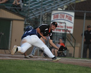 Shane Eynon of Springfield gets ready to tag out Alex Hernandez (12) of Warren JFK as he attempted to slide into home during the district championship matchup at Cene Park in Struthers on Thursday night.   Dustin Livesay     The Vindicator  5/23/19  Cene Park.