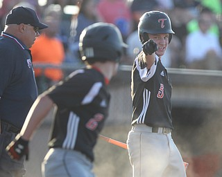 John Slike (5) points in celebration to his brother Nick Slike (2) after he crossed home plate during the district championship matchup against Warren JFK at Cene Park in Struthers on Thursday night.   Dustin Livesay     The Vindicator  5/23/19  Cene Park.