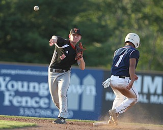 John Slike (5) of Springfield looks to turn a double play after getting Jordan Edmondson (1) of Warren JFK out at second during the dictrict championship matchup at Cene Park in Struthers on Thursday night.   Dustin Livesay     The Vindicator  5/23/19  Cene Park.