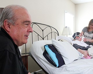 William D. Lewis The Vindicator Ron Moschella, longtime area girls basketball coach, spends time with his daughter Christine Terlesky who has ALS.