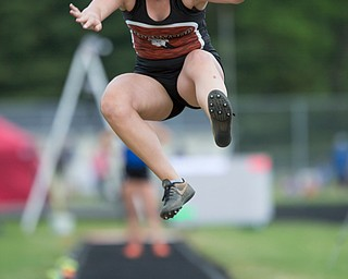 Ridgewood's Abbey Kellish competes in the girls' long jump during the Division III regional track meet at Massillon Perry High School on Friday. EMILY MATTHEWS | THE VINDICATOR