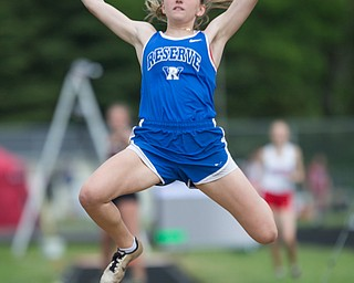 Western Reserve's Maddy Owen competes in the girls' long jump during the Division III regional track meet at Massillon Perry High School on Friday. EMILY MATTHEWS | THE VINDICATOR