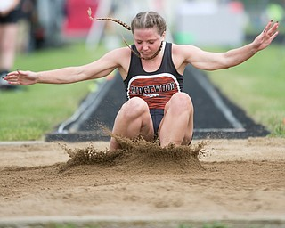 Ridgewood's Alexis Prater competes in the girls' long jump during the Division III regional track meet at Massillon Perry High School on Friday. Prater came in first with a distance of 17-02.50 ft.EMILY MATTHEWS | THE VINDICATOR