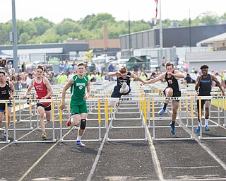 From left, Crestview's William Hardenbrook, Mathews's John Smith, Badger's Brandon Greathouse, Mogadore's Connor Kerr, United's Jaret Hahn, Shadyside's Jakob Klug, Lutheran East's CyLyn McSwain, and Steub. Cath. Cent's Michael Herrmann compete in the boys 110 hurdles during the Division III regional track meet at Massillon Perry High School on Friday. EMILY MATTHEWS | THE VINDICATOR