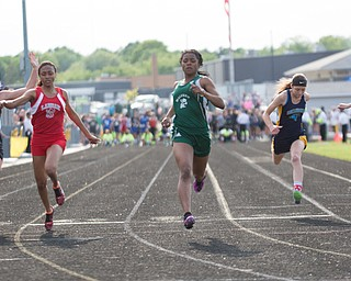 From left, Ridgewood's Alexis Prater, LaBrae's Dynesty Ervin, Malvern's Zoe Moser, Hillsdale's Jordan Taylor, and Cornerstone Christian's Abby Suszek compete in the girls 100 dash during the Division III regional track meet at Massillon Perry High School on Friday. EMILY MATTHEWS | THE VINDICATOR