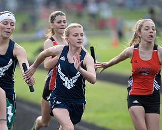 McDonald's Brooke Lewis, left, passes the baton to Jessica Stamp in the girls 800 relay during the Division III regional track meet at Massillon Perry High School on Friday. EMILY MATTHEWS | THE VINDICATOR