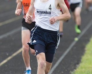 McDonald's Brody Rupe competes in the boys 1600 run during the Division III regional track meet at Massillon Perry High School on Friday. EMILY MATTHEWS | THE VINDICATOR