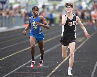 Shadyside's Chase Stewart makes a gesture as he crosses the finish line ahead of East Canton's Demetrius Snellenberger during the Division III regional track meet at Massillon Perry High School on Friday. EMILY MATTHEWS | THE VINDICATOR