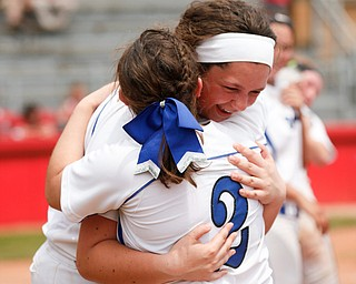 Poland's Ally Nittoli and Camryn Lattanzio (2) hug after beating Crestwood to win the Division II regional finals at Firestone Stadium in Akron on Saturday. EMILY MATTHEWS | THE VINDICATOR