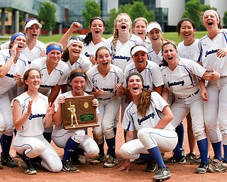 The Poland softball team celebrates after beating Crestwood to win the Division II regional finals at Firestone Stadium in Akron on Saturday. EMILY MATTHEWS | THE VINDICATOR