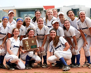 The Poland softball team smiles for a group photo after beating Crestwood to win the Division II regional finals at Firestone Stadium in Akron on Saturday. EMILY MATTHEWS | THE VINDICATOR