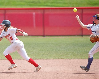 Poland's Lauren Sienkiewicz throws the ball to third to get Crestwood's Isabella Sorboro out during their Division II regional final game at Firestone Stadium in Akron on Saturday. EMILY MATTHEWS | THE VINDICATOR