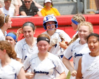 Poland's Ashley Wire celebrates with her team after hitting a home run during their Division II regional final game against Crestwood at Firestone Stadium in Akron on Saturday. EMILY MATTHEWS | THE VINDICATOR