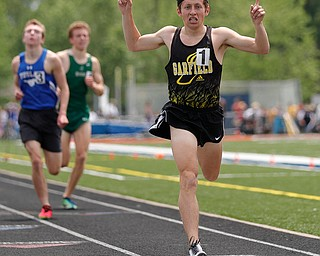 AUSTINTOWN, OHIO - May 25, 2019: Track & Field  D2 Region at Austintown-Fitch High School. .Boys 1600m. Garfield's Tyler Klouda crosses the line in 1st, Photo by MICHAEL G. TAYLOR | THE VINDICATOR