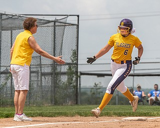 DIANNA OATRIDGE | THE VINDICATOR  Champion's Allison Smith (6) reaches for Coach Cheryl Weaver's hand as she rounds third and heads home after hitting a solo home run during the Division III Regional Final against Northwestern on Saturday in Massillon.