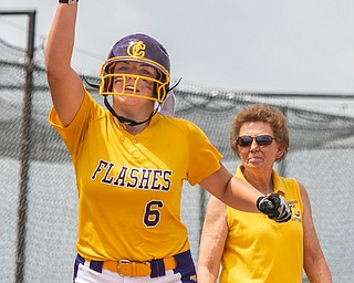 DIANNA OATRIDGE | THE VINDICATOR  Champion's Allison Smith (6) gestures in celebration after hitting a solo home run as Coach Cheryl Weaver looks on during the Division III Regional Final against Northwestern on Saturday in Massillon.