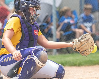 DIANNA OATRIDGE | THE VINDICATOR  Champion catcher Gabby Hollenbaugh concentrates on making a catch during their Division III Regional Final game versus Northwestern on Saturday in Massillon. Champion won 3-0.