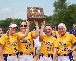 DIANNA OATRIDGE | THE VINDICATOR  Champion team captains Carli Swipas (22), Abby Grace (25), Skye Kennedy-Snodgrass (24), and Gabby Hollenbaugh (12) raise the Division III Regional Championship trophy after defeating Northwestern 3-0 on Saturday in Massillon.