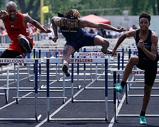AUSTINTOWN, OHIO - May 24, 2019: Track & Field  D2 Region at Austintown-Fitch High School. .Boys 110m. Youngstown East's Tobias Hayes clears the last hurdle and finishes 2nd in a time of 14.59 secs. to qualify for the state meet, Photo by MICHAEL G. TAYLOR | THE VINDICATOR
