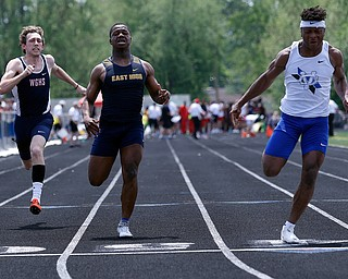 AUSTINTOWN, OHIO - May 24, 2019: Track & Field  D2 Region at Austintown-Fitch High School. .Boys 100m. Youngstown East's Giovanni Washington (middle) takes 2nd place to qualify for the state meet, Photo by MICHAEL G. TAYLOR | THE VINDICATOR