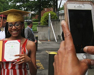 William Dlewis The vindicator Mooney grad Joclynnthompson is all smiles as she she is photogrpaphedby a friend.