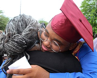 William D. Lewis the vindicator  Mooney grad Andre Carter gets a hug from his aunt Cynthia Carter after graduation 5-26 at Stambaugh.