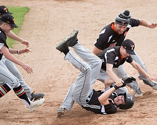 Springfield players pile on top of Clayton Nezbeth after he hit the game-winning run in against Mathews at Strongsville High School on Tuesday. Springfield won 3-2. EMILY MATTHEWS   THE VINDICATOR