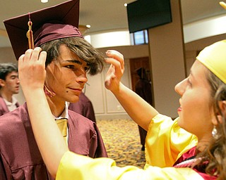 William D. Lewis The Vindicator   Liberty grad Ettore Campriani gets some help before graduation from fellow grad and valedictorian Ashley Fabian at Stambaugh Auditorium 5-3-19.