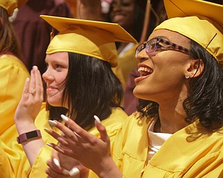 William D. Lewis the Vindicator   Liberty grads Kayla Baker and Mya Atwood applaud during 5-3-19 commencement at Stambaiugh Auditorium