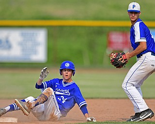 HUDSON, OHIO - MAY 31, 2019: Gilmour Academy's Garrett Olsen, left, reacts to being tagged out by Poland's Braeden O'Shaughnessy in the second inning of Friday nights OHSAA Division II Regional Semi-Final game at Hudson High School. Gilmour Academy won 11-0. DAVID DERMER | THE VINDICATOR