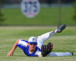HUDSON, OHIO - MAY 31, 2019: Poland's Ian Lu looks at the ball in his glove after diving to take a hit away from Gilmour Academy's Marco Costabile in the third inning of Friday nights OHSAA Division II Regional Semi-Final game at Hudson High School. Gilmour Academy won 11-0. DAVID DERMER | THE VINDICATOR
