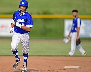 HUDSON, OHIO - MAY 31, 2019: Gilmour Academy's Nick Christopher runs the bases after hitting a 3-run home run in the fourth inning of Friday nights OHSAA Division II Regional Semi-Final game at Hudson High School. Gilmour Academy won 11-0. DAVID DERMER | THE VINDICATOR