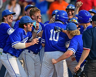 HUDSON, OHIO - MAY 31, 2019: Gilmour Academy's Nick Christopher (10) is mobbed at home plate by his teammates after hitting a 3-run home run in the fourth inning of Friday nights OHSAA Division II Regional Semi-Final game at Hudson High School. Gilmour Academy won 11-0. DAVID DERMER | THE VINDICATOR