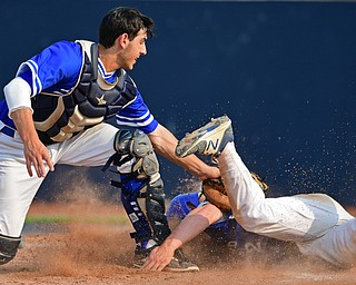 HUDSON, OHIO - MAY 31, 2019: Gilmour Academy's Nick Christopher tags out Poland's Alex Barth at home plate in the fourth inning of Friday nights OHSAA Division II Regional Semi-Final game at Hudson High School. Gilmour Academy won 11-0. DAVID DERMER | THE VINDICATOR