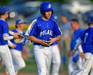 HUDSON, OHIO - MAY 31, 2019: Poland's Jeremy Castro walks to the dugout after flying out to end the game in the seventh inning of Friday nights OHSAA Division II Regional Semi-Final game at Hudson High School. Gilmour Academy won 11-0. DAVID DERMER | THE VINDICATOR