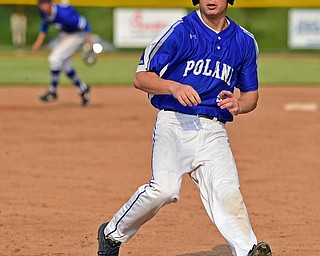 HUDSON, OHIO - MAY 31, 2019: Poland's Poland's Ian Lu runs into third base for a triple in the third inning of Friday nights OHSAA Division II Regional Semi-Final game at Hudson High School. Gilmour Academy won 11-0. DAVID DERMER | THE VINDICATOR