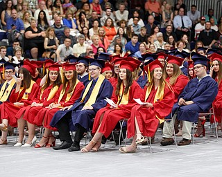 Austintown Fitch seniors wait to graduate in the Austintown Fitch High School gymnasium Saturday morning. EMILY MATTHEWS | THE VINDICATOR