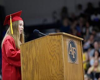 Faith Marscio, the Austintown Fitch High School Senior Class President, gives a farewell message during the Austintown Fitch commencement ceremony in the school's gymnasium Saturday morning. EMILY MATTHEWS | THE VINDICATOR