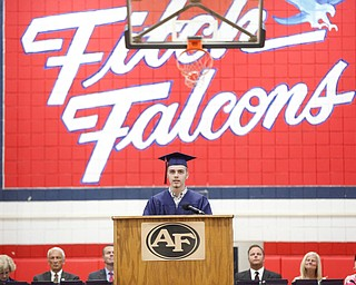 Brandon Smith, MCCTC senior class speaker, gives a farewell message during the Austintown Fitch commencement ceremony in the school's gymnasium Saturday morning. EMILY MATTHEWS | THE VINDICATOR