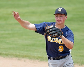 Hillsdale's Ty Williams throws the ball to first during their game against Springfield at Strongsville High School on Saturday. Hillsdale won 16-2. EMILY MATTHEWS | THE VINDICATOR