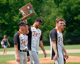Springfield's Shane Eynon holds up their second place trophy as Jarrett Orbin, left, and Brannon Brungard walk next to him after their game against Hillsdale at Strongsville High School on Saturday. Springfield lost 16-2. EMILY MATTHEWS | THE VINDICATOR