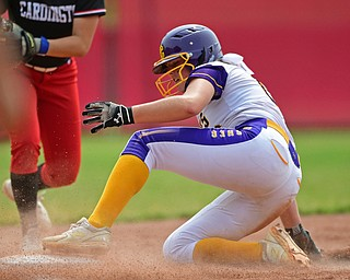AKRON, OHIO - JUNE 1, 2019: Champion's Allison Smith slides into third base after advancing on a double by Abbi Grace in the sixth inning of the OHSAA Division III Championship game, Saturday morning at Firestone Stadium in Akron. Champion won 5-0. DAVID DERMER | THE VINDICATOR