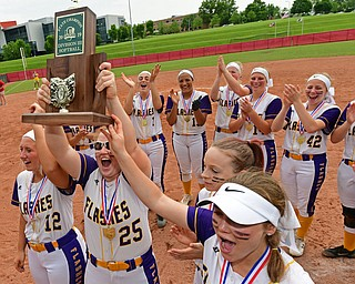 AKRON, OHIO - JUNE 1, 2019: Champion's Abby White raises the State Championship Trophy in celebration after defeating Cardington-Lincoln 5-0 to win the Division III State Softball Championship, Saturday morning at Firestone Stadium. DAVID DERMER | THE VINDICATOR