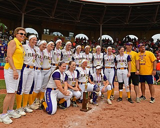 AKRON, OHIO - JUNE 1, 2019: Players and coaches for Champion pose for a team picture after defeating Cardington-Lincoln 5-0 to win the Division III State Softball Championship, Saturday morning at Firestone Stadium. DAVID DERMER | THE VINDICATOR
