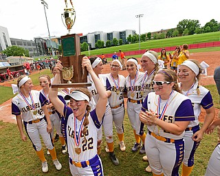 AKRON, OHIO - JUNE 1, 2019: Champion's Carli Swipas raises the State Championship Trophy in celebration after defeating Cardington-Lincoln 5-0 to win the Division III State Softball Championship, Saturday morning at Firestone Stadium. DAVID DERMER | THE VINDICATOR