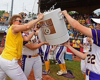 AKRON, OHIO - JUNE 1, 2019: Champion head coach Cheryl Weaver, left, fights off a Gatorade bath from Carli Swipas after defeating Cardington-Lincoln 5-0 to win the Division III State Softball Championship, Saturday morning at Firestone Stadium. DAVID DERMER | THE VINDICATOR